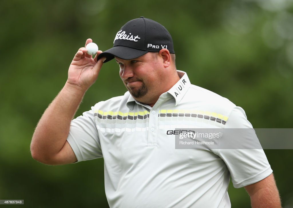 Brendon de Jonge of Zimbabwe aknowledges the crowd as he finishes his course record equalling round of 62 during the second round of the Wells Fargo Championship at the Quail Hollow Club on May 2, 2014 in Charlotte, North Carolina.