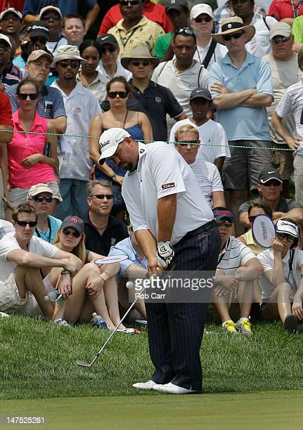 Brendon de Jonge of Zimbabwe chips to the green on the second hole during the Final Round of the ATT National at Congressional Country Club on July 1...