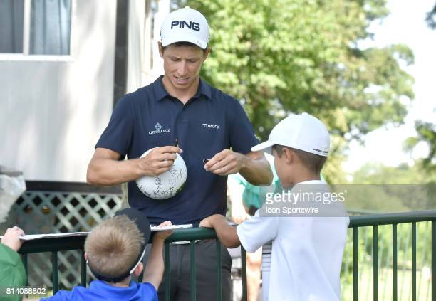Brendon de Jonge signs autographs after completing his round during the first round of the John Deere Classic July 13 at TPC Deere Run Silvis IL
