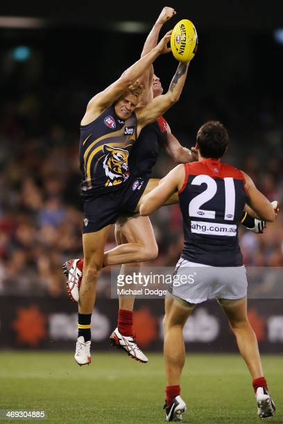 Brendon Ellis of the Tigers marks the ball during the round one AFL NAB Challenge Cup match between the Richmond Tigers and the Melbourne Demons at...