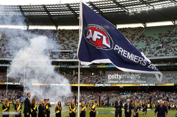 Brendon Gale and Peggy O'Neal unfurl the 2017 premiership flag during the 2018 AFL round 01 match between the Richmond Tigers and the Carlton Blues...