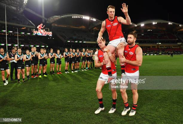 Brendon Goddard gets shouldered off by Michael Hurley and Cale Hooker of the Bombers during the round 23 AFL match between Port Adelaide Power and...