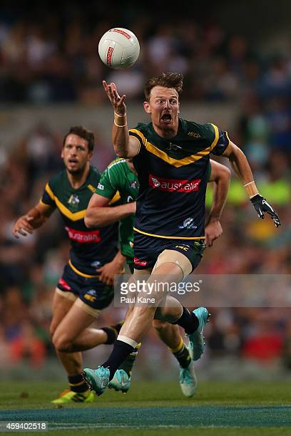 Brendon Goddard of Australia gathers the ball during the International Rules Test Match between Australia and Ireland at Patersons Stadium on...