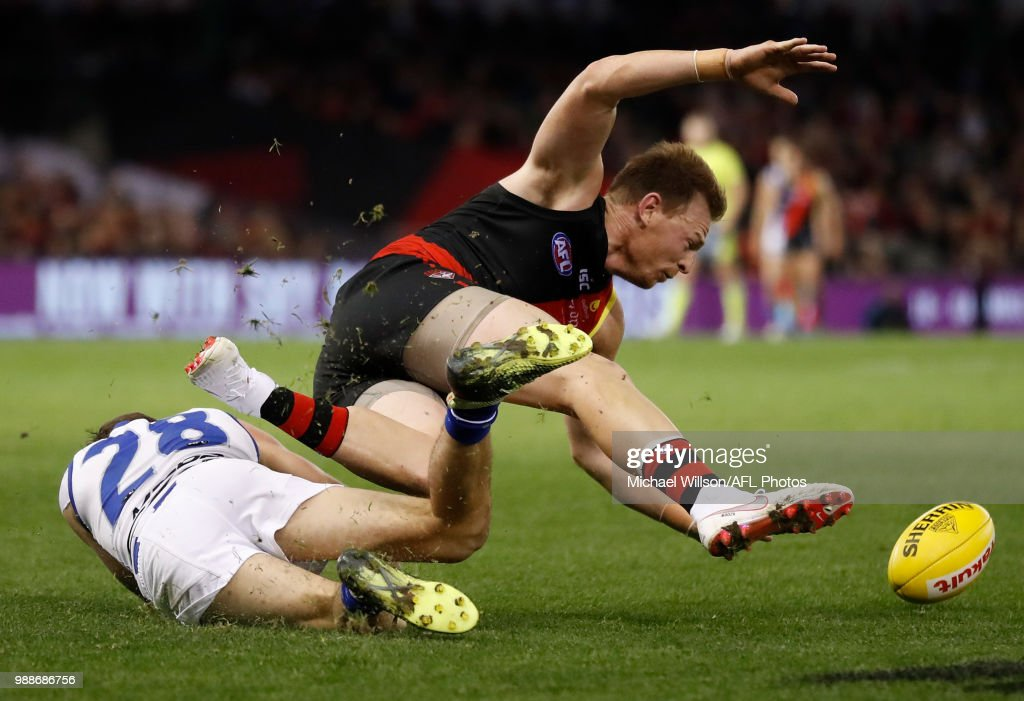 Brendon Goddard of the Bombers and Kayne Turner of the Kangaroos compete for the ball during the 2018 AFL round15 match between the Essendon Bombers and the North Melbourne Kangaroos at Etihad Stadium on July 01, 2018 in Melbourne, Australia.