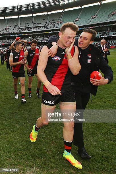 Brendon Goddard of the Bombers celebrates the win with Orazio Fantasia of the Bombers during the round 23 AFL match between the Essendon Bombers and...
