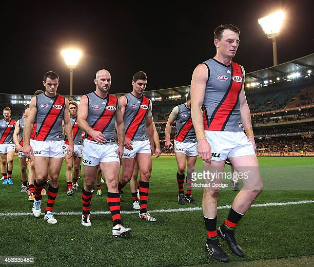 Brendon Goddard of the Bombers leads the team off after their defeat during the round 20 AFL match between the Richmond Tigers and the Essendon...