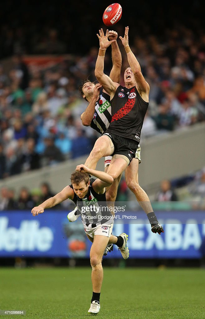 Brendon Goddard of the Bombers leaps for a high mark attempt over Sam Dwyer of the Magpies during the round four AFL match between the Essendon Bombers and the Collingwood Magpies at Melbourne Cricket Ground on April 25, 2015 in Melbourne, Australia.