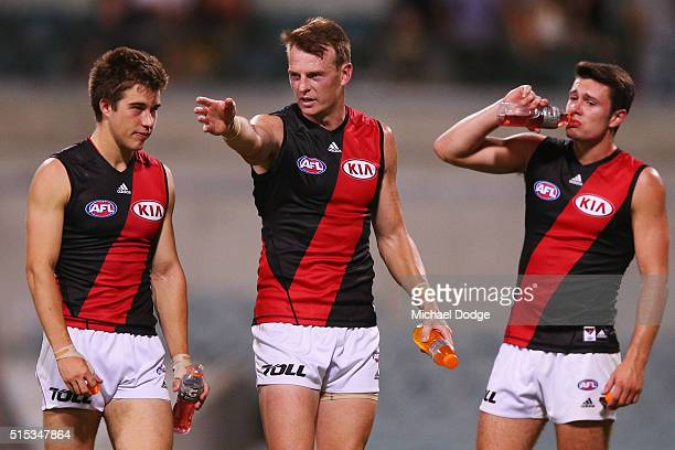 Brendon Goddard of the Bombers speaks to Zach Merrett of the Bombers after their defeat during the NAB Challenge AFL match between the West Coast...