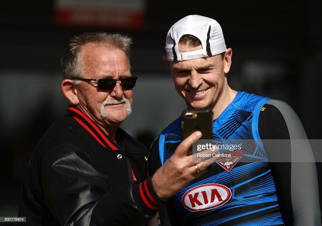 Brendon Goddard of the Bombers takes a photo with a fan during an Essendon Bombers AFL training session at the Essendon Football Club on August 16, 2017 in Melbourne, Australia.