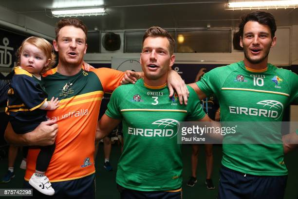 Brendon Goddard Shaun Higgins and Robbie Tarrant of Australia celebrate after winning game two and the series of the International Rules Series...