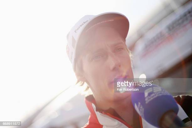 Brendon Hartley of New Zealand and Porsche LMP Team is interviewed by the media following qualifying for the FIA World Endurance Championship at...