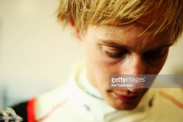 Brendon Hartley of New Zealand and Porsche Team 919 Hybrid talks to the media during previews the FIA World Endurance Championship Six Hours of...