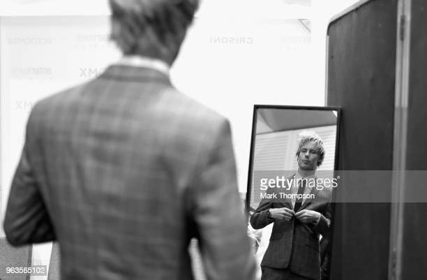 Brendon Hartley of New Zealand and Scuderia Toro Rosso prepares backstage at the Amber Lounge Fashion show during previews ahead of the Monaco...