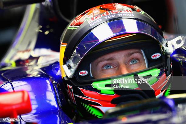 Brendon Hartley of New Zealand and Scuderia Toro Rosso prepares to drive in the garage during practice for the Formula One Grand Prix of Mexico at...