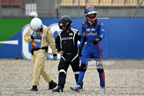 Brendon Hartley of New Zealand and Scuderia Toro Rosso walks from his car after crashing during final practice for the Spanish Formula One Grand Prix...