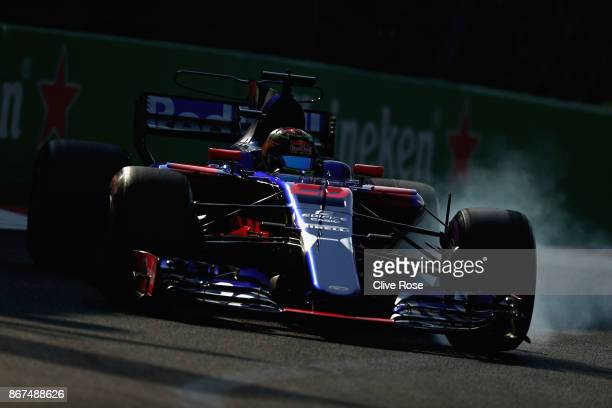Brendon Hartley of New Zealand driving the Scuderia Toro Rosso STR12 locks a wheel under braking during final practice for the Formula One Grand Prix...
