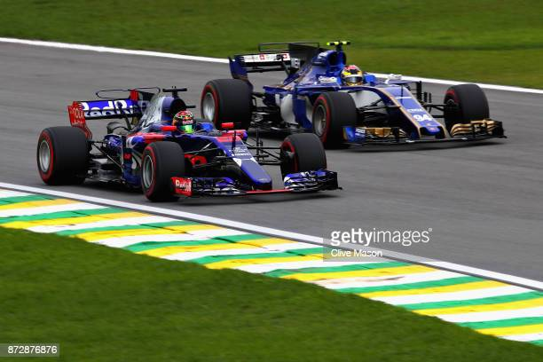 Brendon Hartley of New Zealand driving the Scuderia Toro Rosso STR12 and Pascal Wehrlein of Germany driving the Sauber F1 Team Sauber C36 Ferrari on...