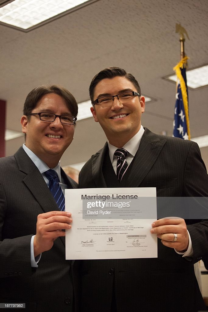 Brendon K. Taga (L) and Jesse Pageat, the second couple to receive a same-sex marriage license in Washington state, pose at the King County Recorder's Office on December 6, 2012 in Seattle, Washington. The office opened at 12:01 AM PST to begin issuing marriage licenses to same-sex couples for the first time, after Washington voters chose to legalize same-sex marriage in November's election.