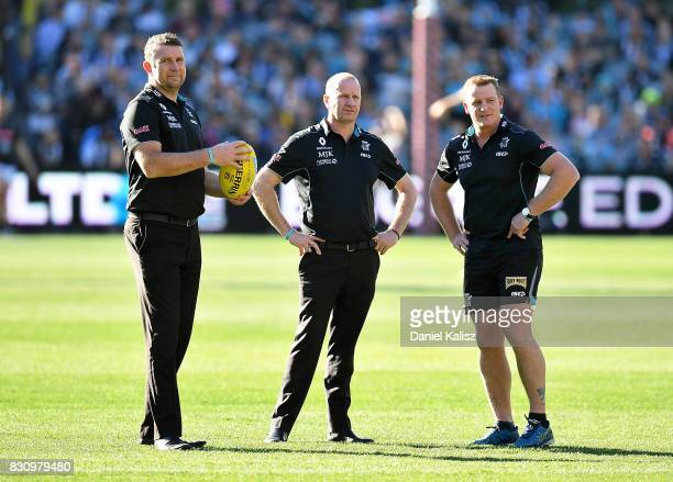 Brendon Lade forwards and rucks coach of the Power Ken Hinkley the coach of the Power and Michael Voss midfield manager of the Power look on during...