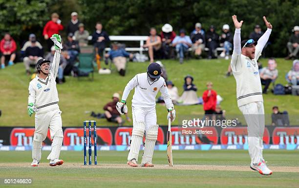 Brendon McCullum and BJ Watling of New Zealand successfully appeal for an LBW decision as Dinesh Chandimal of Sri Lanka looks on during day five of...