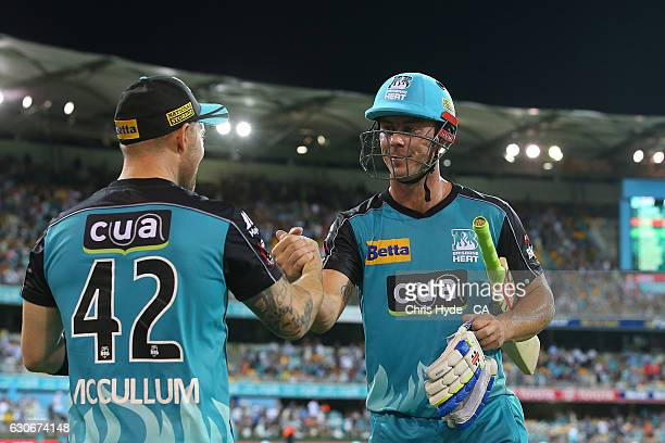 Brendon McCullum and Chris Lynn of the Heat celebrate winning the Big Bash League between the Brisbane Heat and Hobart Hurricanes at The Gabba on...