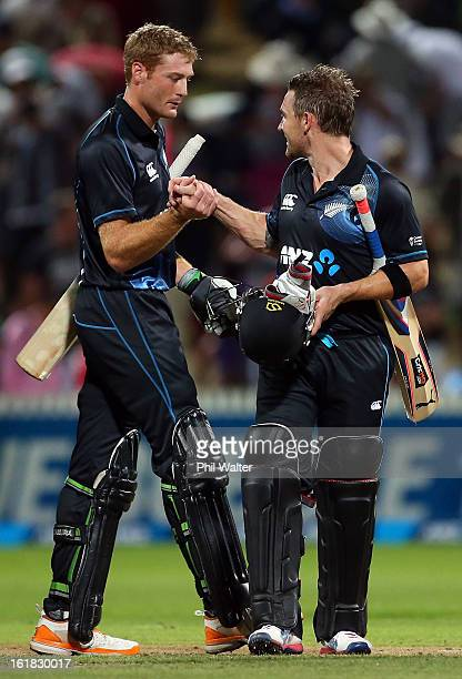 Brendon McCullum and Martin Guptill of New Zealand celebrate the win following the first match of the one day international series between New...