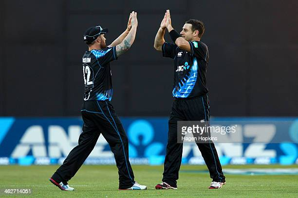 Brendon McCullum and Nathan McCullum of New Zealand celebrate the wicket of Dwayne Bravo of the West Indies during the game two of the Twenty20...