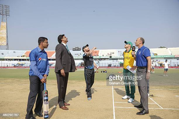 Brendon McCullum captain of New Zealand tosses the coin with Francois du Plessis captain of South Africa match referee Javagal Srinath Pepsi mascot...