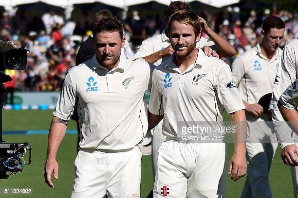 Brendon McCullum captain of New Zealand with team mate Kane Williamson walk from the field after the national anthems during day one of the second...