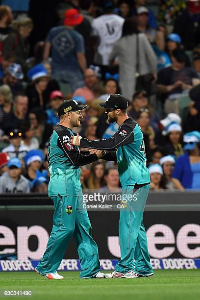 Brendon McCullum celebrates with Alex Ross of the Brisbane Heat after taking a catch during the Big Bash League match between the Adelaide Strikers...