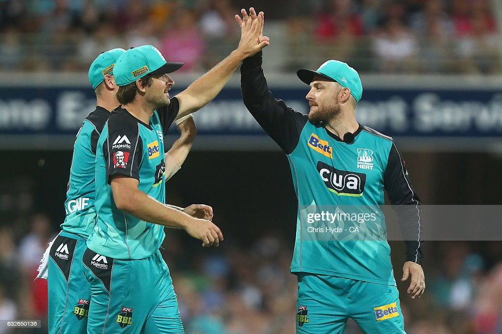 Brendon McCullum celebrates with Joe Burns of the Heat after the wicket of Moises Henriques of the Sixers during the Big Bash League semi final match between the Brisbane Heat and the Sydney Sixers at the The Gabba on January 25, 2017 in Brisbane, Australia.