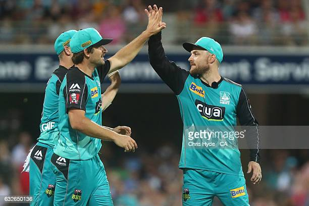 Brendon McCullum celebrates with Joe Burns of the Heat after the wicket of Moises Henriques of the Sixers during the Big Bash League semi final match...