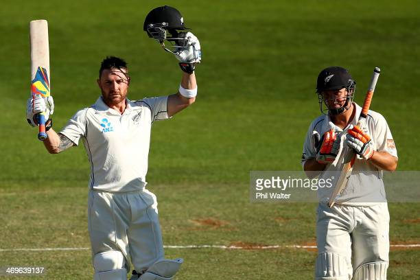 Brendon McCullum of New Zealand celebrates his century as BJ Watling looks on during day three of the 2nd Test match between New Zealand and India at...