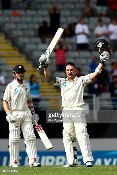 Brendon McCullum of New Zealand celebrates his century as Kane Williamson looks on during day one of the First Test match between New Zealand and...