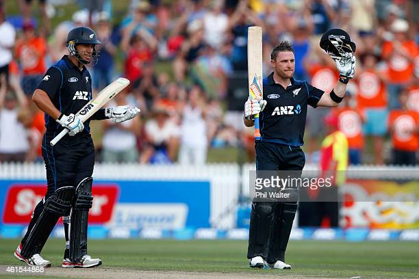Brendon McCullum of New Zealand celebrates his century as Ross Taylor watches on during the One Day International match between New Zealand and Sri...