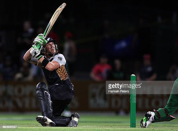 Brendon McCullum of New Zealand flicks the ball over his wickets for four runs the Twenty20 International match between New Zealand and Bangladesh at...
