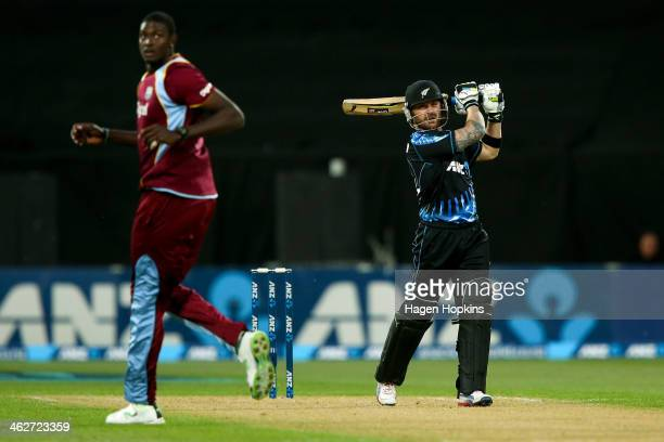 Brendon McCullum of New Zealand hits a six while Jason Holder of the West Indies looks on during the game two of the Twenty20 series between New...