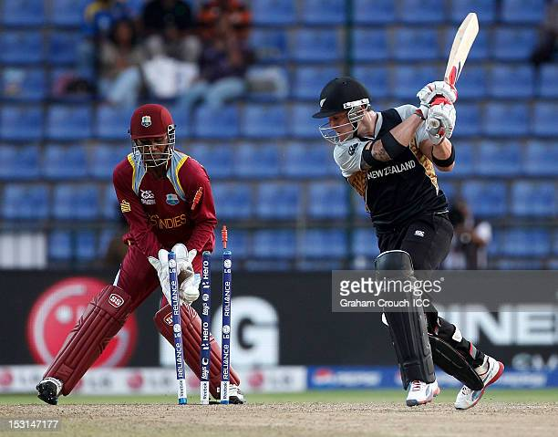 Brendon McCullum of New Zealand is bowled by Samuel Badree of West Indies during the Super Eights Group 1 match between New Zealand and West Indies...