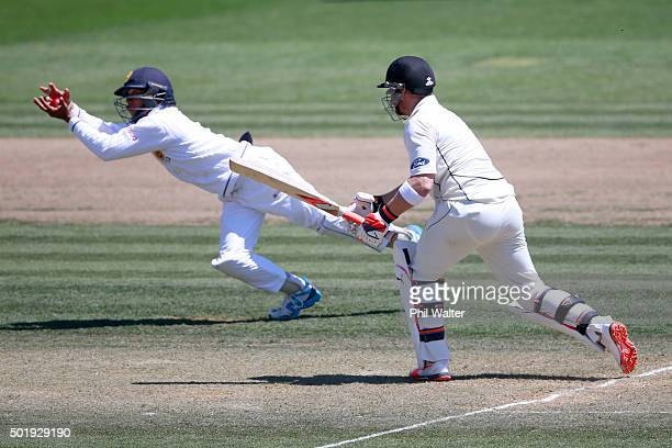 Brendon McCullum of New Zealand is caught out by Kusal Mendis of Sri Lanka during day two of the Second Test match between New Zealand and Sri Lanka...
