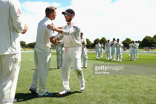 Brendon McCullum of New Zealand is congratuated by David Warner of Australia after his final test match during day five of the Test match between New...