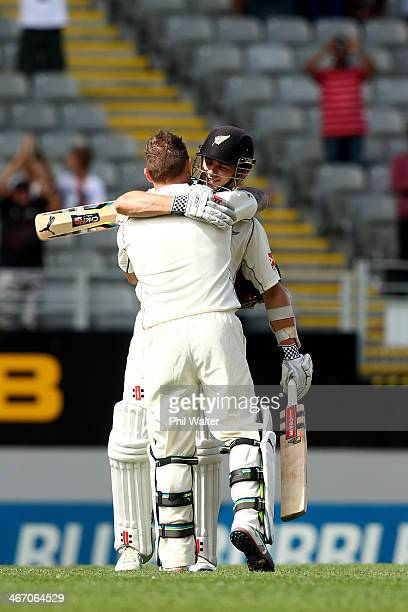 Brendon McCullum of New Zealand is congratulaed on his century by Kane Williamson during day one of the First Test match between New Zealand and...