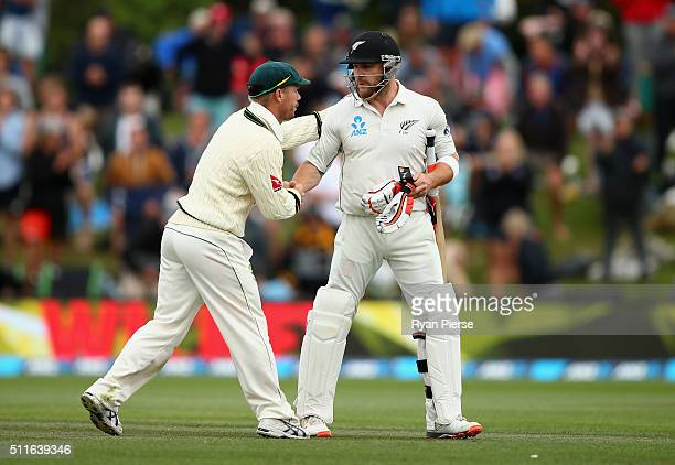 Brendon McCullum of New Zealand is congraulated by David Warner of Australia as he walks from the ground after his final test innings during day...