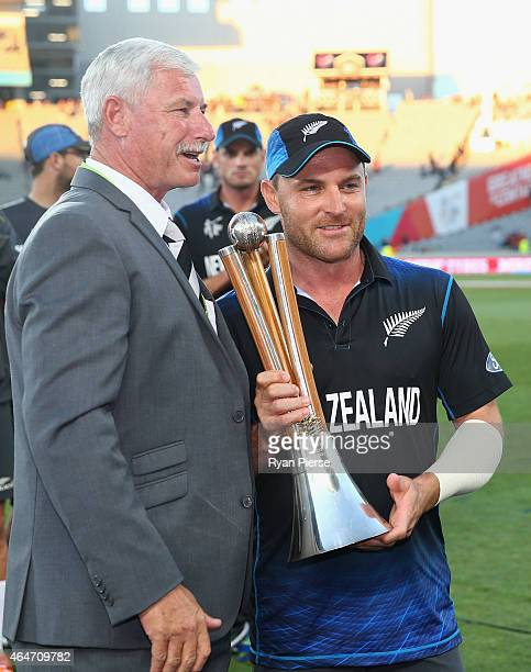 Brendon McCullum of New Zealand is presented the Chappell Hadlee Trophy by Sir Richard Hadlee after the 2015 ICC Cricket World Cup match between...