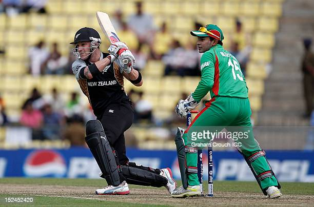 Brendon McCullum of New Zealand sweeps in front of Bangladesh's Mushfiqur Rahim during the ICC World T20 Group D match between New Zealand and...