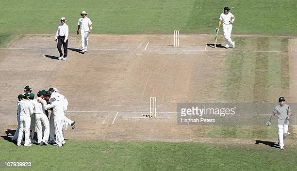 Brendon McCullum of the Black Caps walks off as Wahab Riaz of Pakistan celebrates during day three of the First Test match between the New Zealand...