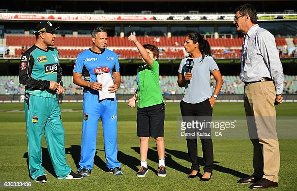 Brendon McCullum of the Brisbane Heat and Brad Hodge of the Adelaide Strikers look on at the toss prior to the Big Bash League match between the...