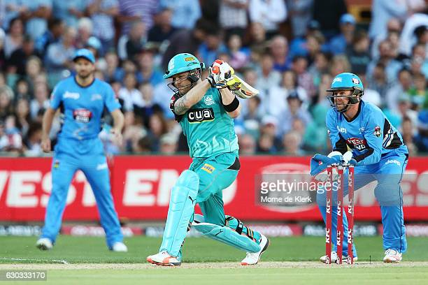 Brendon McCullum of the Brisbane Heat bats in front of Ben Dunk of the Adelaide Strikers during the Big Bash League match between the Adelaide...