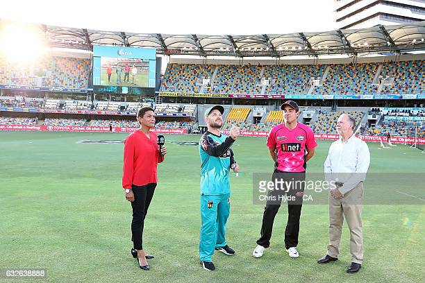 Brendon McCullum of the Heat and Moises Henriques of the Sixers coin toss before the Big Bash League semi final match between the Brisbane Heat and...