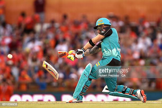 Brendon McCullum of the Heat breaks his bat as he plays a shot during the Big Bash League match between the Perth Scorchers and the Brisbane Heat at...
