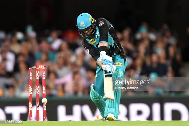Brendon McCullum of the Heat is clean bowled off the bowling of Matthew Kelly of the Scorchers during the Big Bash League match between the Brisbane...